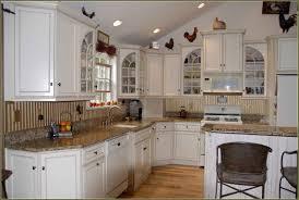 white upper cabinets dark lower bird cabinet knobs drawer pulls
