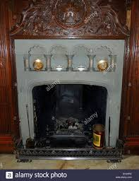 jacobean 17th century english stone fireplace with wooden facia