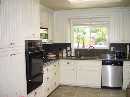 recycled countertops white beadboard kitchen cabinets lighting