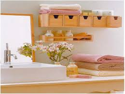 small bathroom storage idea with diy shelving over the toilet