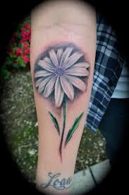 right forearm daisy flower tattoo
