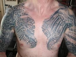 tribal tattoos on chest and arms real photo pictures images and