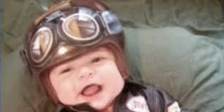 tattoo artist paints infant u0027s head shaping helmet turns him into