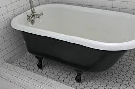 black and white bear claw tub on rounded bathroom floor tile of