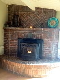 brick fireplace corner placement red brick herringbone detail