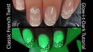 classic french ombre with a glow in the dark chain twist nail art