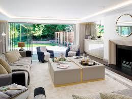 recessed lights white baseboards crown molding beige sofa framed