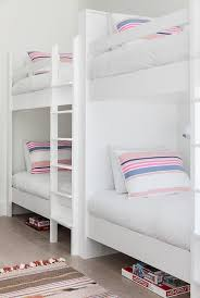 Bunk Beds Pink White Bunk Beds With Pink And Blue Striped Pillows