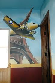 47 best aviation images on pinterest planes aviation and for those that love travel the golden gate bridge in one corner of the room and the eiffel tower in the other real plane parts accessorize the mural