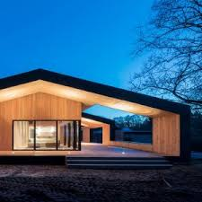 home architecture oversized roof shelters terraces at cebra s summer house