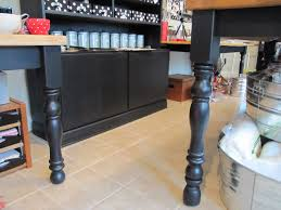 add finials or bed risers to the bottom of table legs to make a