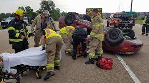 vehicle overturns in two car crash at illinois state route 143 and