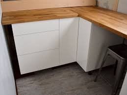 floating kitchen cabinets ikea white floating cabinet with brown wooden top connected by grey tile