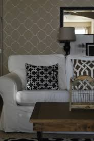 simple and cozy wallpaper accent wall living room image 5