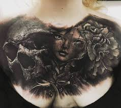 brilliant face and skull with flower tattoo on chest