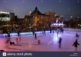 people ice skating outside at karlsplatz munich at christmas in