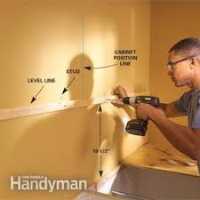 how to attach kitchen base cabinets how to install kitchen cabinets diy family handyman