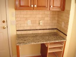 rustice beige subway tile backsplash with skinny trim row placed