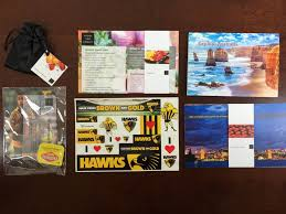 kitchen table passport subscription box review australia 15 the contents of the kit at bottom left and center are the mementos tiny items suitable for passing around the table at bottom right is the stack of