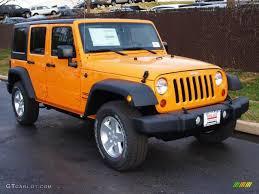 yellow jeep wrangler unlimited dozer yellow 2013 jeep wrangler unlimited sport s 4x4 exterior photo