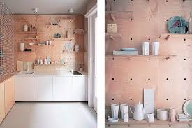 pegboard kitchen ideas this studio apartment has a beautiful peg board storage wall