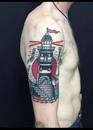 first tattoo lighthouse by dani queipo seven doors tattoo