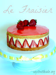layered tres leche cake with strawberries say it with cake