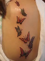 small butterfly on side rib
