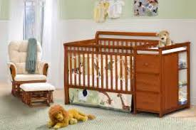 home ideas nursery crib next to changing table 3 in 1 with black