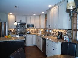 remodeled kitchens with islands white kitchen cabinets black island nice back splash lighting