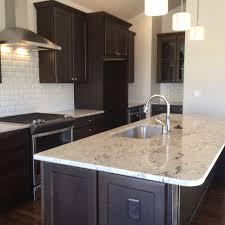 espresso kitchen cabinets with white countertops gourmet kitchen features colonial white granite espresso