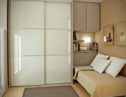 ceremonious small guest room decors with white gloss sliding door