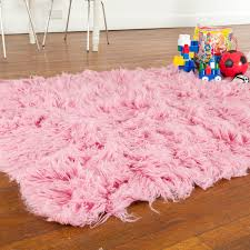 Make Your Home Beautiful With Accessories Accessories Pink Flokati Rug On Wood Flooring In Kids Bedroom