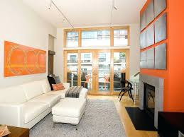 orange accents for living room design with brown furniture living