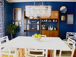contemporary dining room with navy rooms theme of wall also