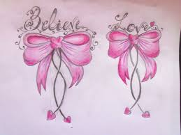 pink ribbon bow tattoos on back of thighs real photo pictures