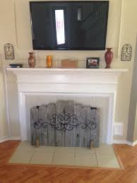 fireplace cover up hide your ugly fireplace behind this easy diy made of weathered