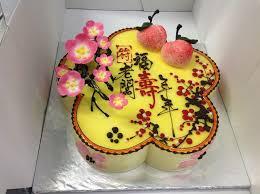 chinese style cherry blossom birthday cake in cherry blossom shape
