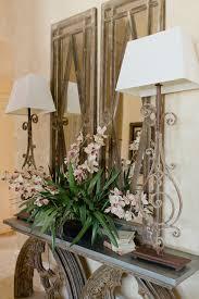 faux orchids decorating with faux floral arrangements