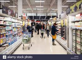 people shopping in the tesco supermarket superstore aberystwyth