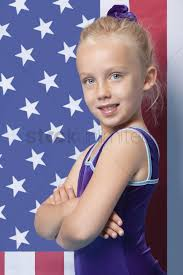 Model American Flag Portrait Of A Happy Young Female Gymnast With Arms Crossed