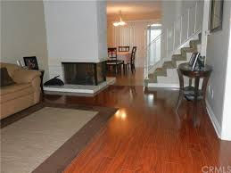 living room and kitchen design laminate in kitchen direction of tile perpendicular to wood living