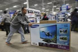 black friday flat screen a man pushes a flat screen television inside best buy during black