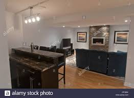 luxury basement living room with gas fireplace and bar stock photo