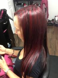 mahogany red hair with high lights dark brown with peekaboo bright red highlights hair nails