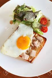 poached tuna plate of breakfast with fried egg tuna vegetables and toast