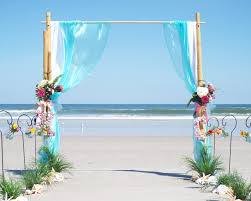 wedding arches bamboo two post bamboo arch aqua organza ceremonies by the sea new smyrna