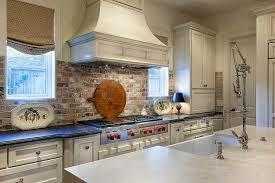 brick backsplash in kitchen lovely kitchen boasts white cabinets paired with honed black