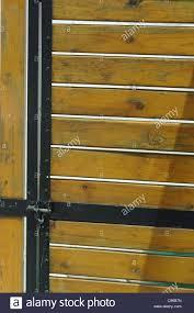 Wood Slats by Wooden Security Door With Black Metal Trim Wood Slats Gate