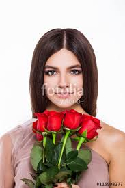 roses and beauty beautiful young woman in pretty dress holding